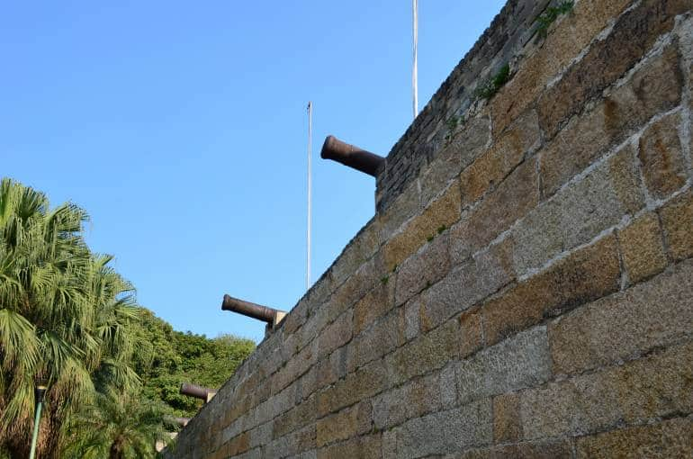 Old cannons protruding from the ramparts of Tung Chung Fort